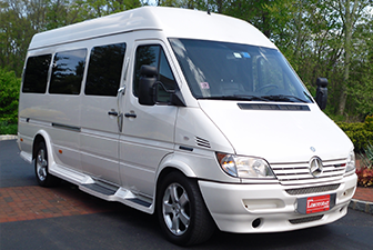 White Mercedes Sprinter Bus